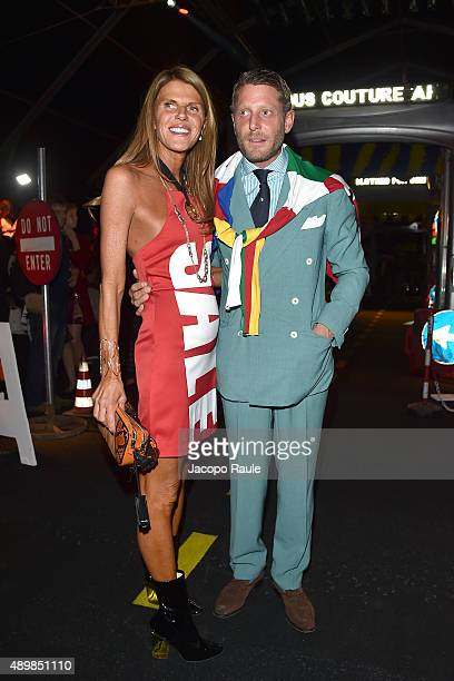 Anna Dello Russo and Lapo Elkann attend the Moschino show during the Milan Fashion Week Spring/Summer 2016 on September 24 2015 in Milan Italy
