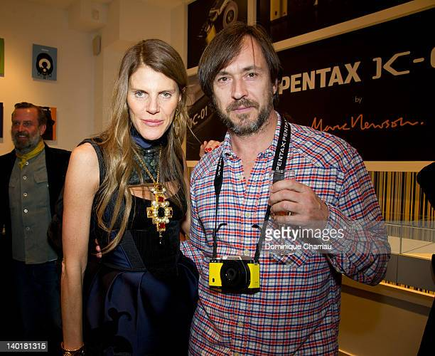 Anna Dello Russo and Marc Newson attend the Marc Newson Pentax The Unveiling Of 'K01' Champagne Cocktail At Colette during Paris Fashion Week at...