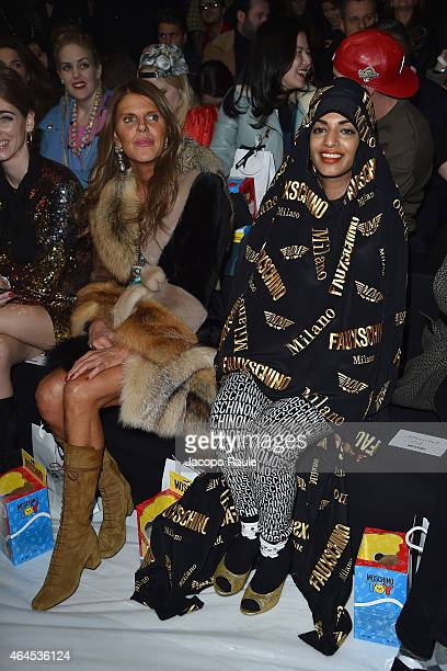 Anna Dello Russo and MIA attend the Moschino show during the Milan Fashion Week Autumn/Winter 2015 on February 26 2015 in Milan Italy