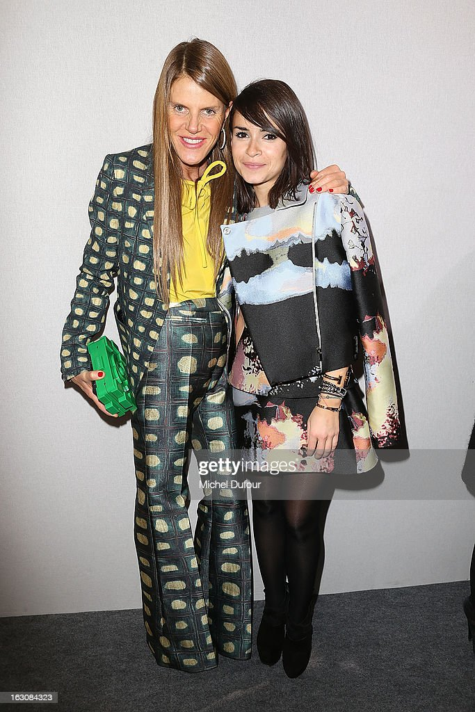 Anna Dello Russo (L) and Miroslava Duma pose together backstage at the Giambattista Valli Fall/Winter 2013 Ready-to-Wear show as part of Paris Fashion Week on March 4, 2013 in Paris, France.
