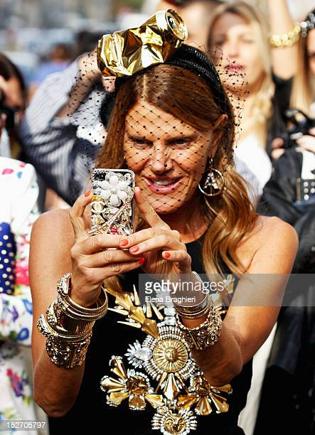Anna Dello Russo attends the Blumarine show and wearing a Stephen Jones Millinery and a Alan Journo headpiece during Milan Fashion Week Womenswear...