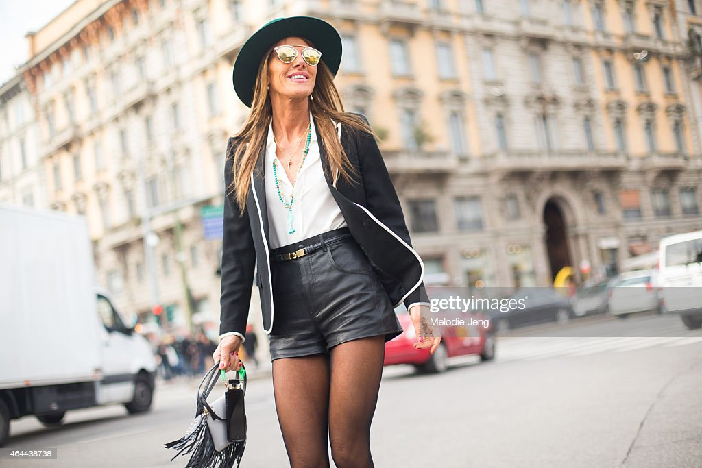 Anna Dello Russo exits the Gucci show in a Saint Laurent Paris outfit on February 25, 2015 in Milan, Italy.