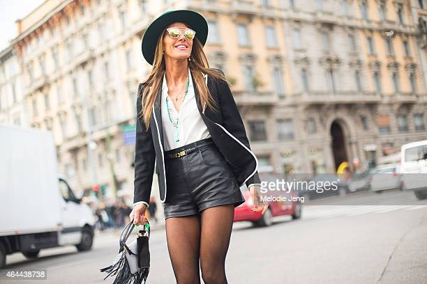 Anna Dello Russo exits the Gucci show in a Saint Laurent Paris outfit on February 25 2015 in Milan Italy