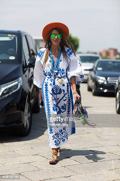 Anna Dello Russo exits the Gucci show in a Vyshyvanka by Vita Kin dress Nick Fouquet hat Loewe bag and Valentino sandals on June 22 2015 in Milan...