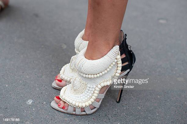 Anna Dello Russo fashion editor at large for Vogue Japan wearing Kanye West by Giuseppe Zanotti shoes at Paris Fashion Week Autumn/Winter 2012 haute...