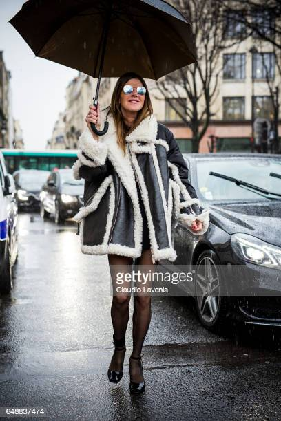 Anna Dello Russo is seen wearing Dsquared2 coat before the Sacai show at the Grand Palais during Paris Fashion Week Womenswear Fall/Winter 2017/2018...
