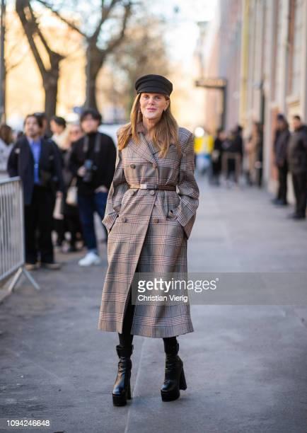 Anna dello Russo is seen wearing flat cap plaid coat outside Fendi during Milan Menswear Fashion Week Autumn/Winter 2019/20 on January 14 2019 in...
