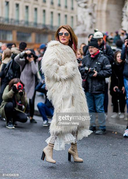 Anna dello Russo is wearing a creme fur coat outside Stella McCartney during the Paris Fashion Week Womenswear Fall/Winter 2016/2017 on March 7 2016...