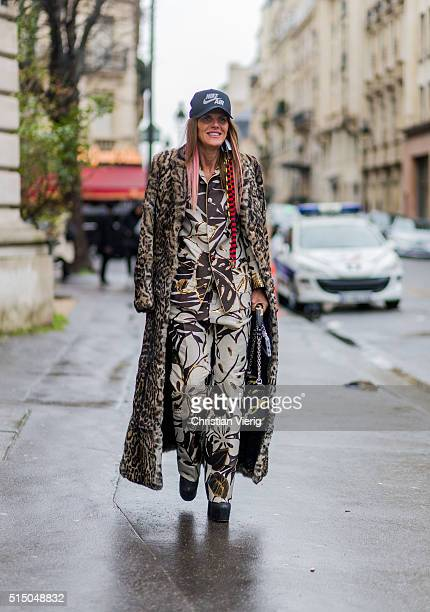 Anna dello Russo is wearing a Nike Air cap a Roberto Cavalli leopard coat and For Restless Sleepers pyjama suit and a Louis Vuitton bag outside...