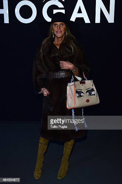 Anna Dello Russo poses at the Hogan presentation as part of Milan Fashion Week Autumn/Winter 2015 on February 26 2015 in Milan Italy