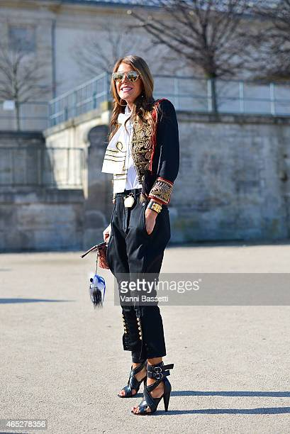 Anna Dello Russo poses wearing a Dsquared jacket and pants and Fendi keychain on Day 3 of Paris Fashion Week Womenswear FW15 on March 5 2015 in Paris...