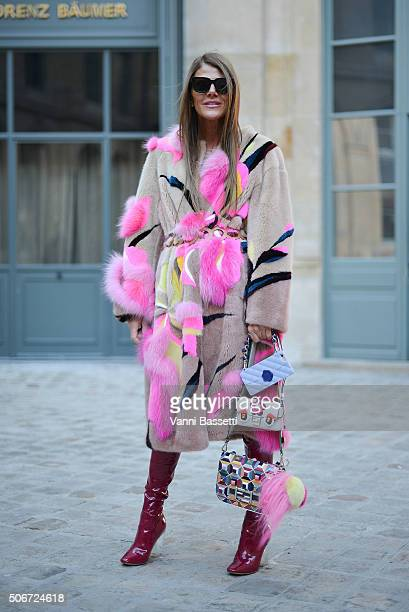 Anna dello Russo poses wearing a Schiaparelli fur Fendi bags and Dior boots before the Schiaparelli show at Place Vendome during Haute Couture on...