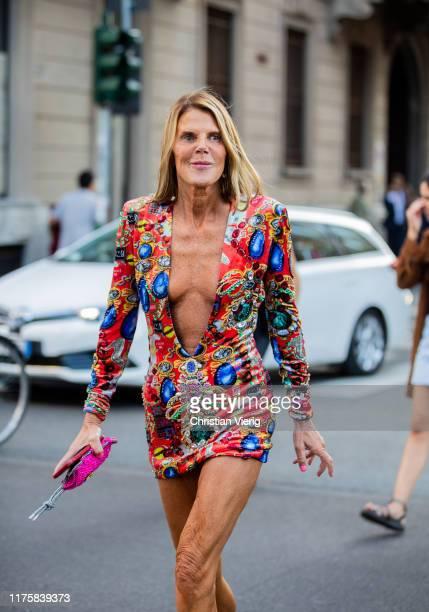 Anna dello Russo seen wearing dress Dolce Gabbana with print outside the Bottega Veneta show during Milan Fashion Week Spring/Summer 2020 on...