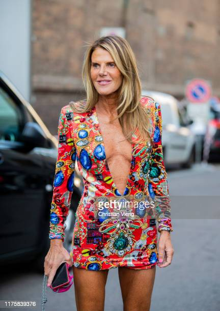 Anna dello Russo seen wearing dress Dolce Gabbana with print outside the Bottega Veneta show during Milan Fashion Week Spring/Summer 2020 on...