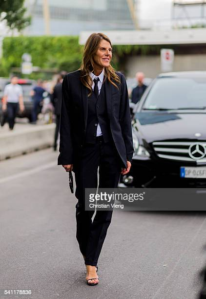 Anna dello Russo wearing a black Dolce Gabbana Man suit outside Versace during the Milan Men's Fashion Week Spring/Summer 2017 on June 18 2016 in...