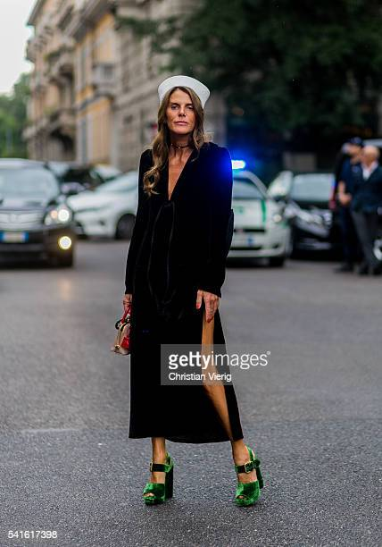 Anna dello Russo wearing a black Prada dress with long sleeves and a white sailor hat outside Prada during the Milan Men's Fashion Week Spring/Summer...