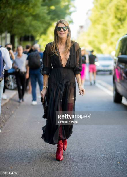 Anna dello Russo wearing a black sheer dress is seen outside Fendi during Milan Fashion Week Spring/Summer 2018 on September 21 2017 in Milan Italy