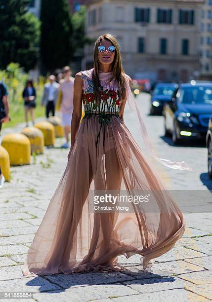 Anna dello Russo wearing a brown Gucci dress outside Gucci during the Milan Men's Fashion Week Spring/Summer 2017 on June 20 2016 in Milan Italy