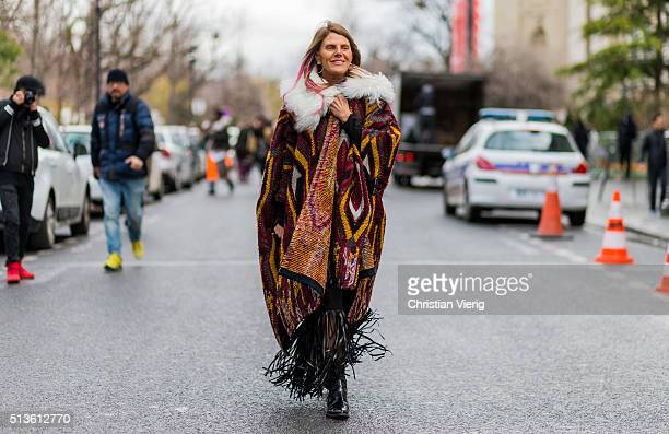 Anna dello Russo wearing a Chloe cape with fur outside Chloe during the Paris Fashion Week Womenswear Fall/Winter 2016/2017 on March 3 2016 in Paris...