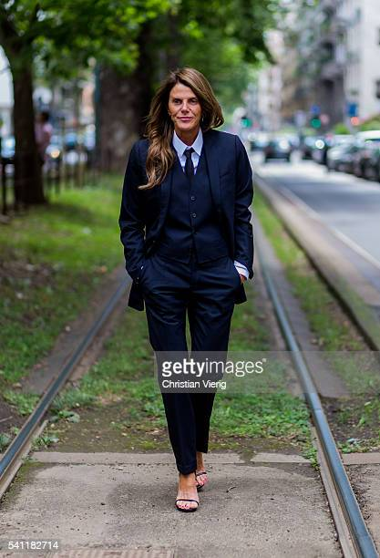 Anna dello Russo wearing a Dolce Gabbana Man suit outside Dolce Gabbana during the Milan Men's Fashion Week Spring/Summer 2017 on June 18 2016 in...