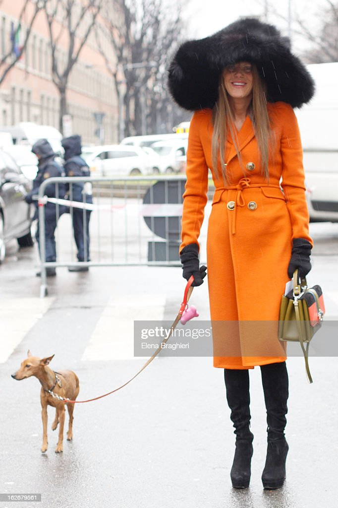 Anna Dello Russo wearing a Marc Jacobs hat and coat, Prada boots and a Paula Cademartori bag at the Milan Fashion Week Womenswear Fall/Winter 2013/14 on February 25, 2013 in Milan, Italy.