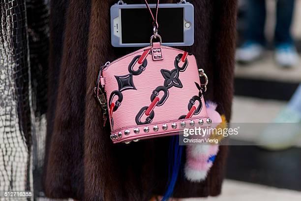 Anna dello Russo wearing a pink Louis Vuitton bag Fendi Simonetta Ravizza fur coat seen outside Blumarine during Milan Fashion Week Fall/Winter...