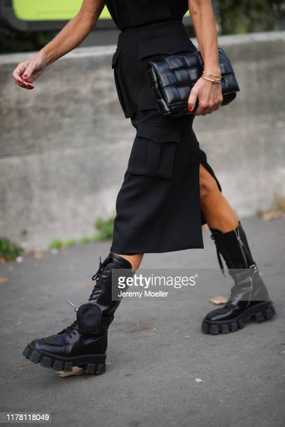 Anna Dello Russo wearing a Prada dress and boots and a Bottega Veneta bag on September 28 2019 in Paris France