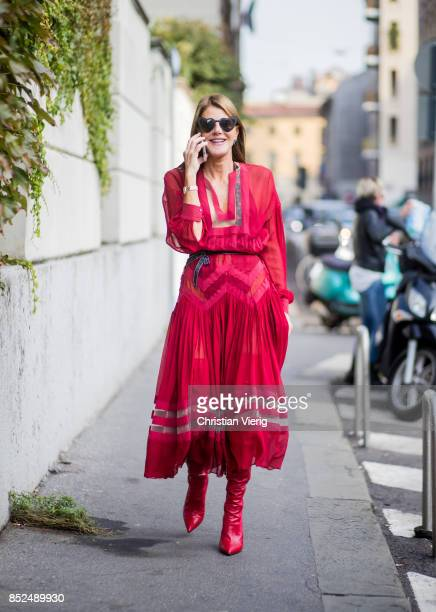 Anna dello Russo wearing a red dress is seen outside Bottega Veneta during Milan Fashion Week Spring/Summer 2018 on September 23 2017 in Milan Italy
