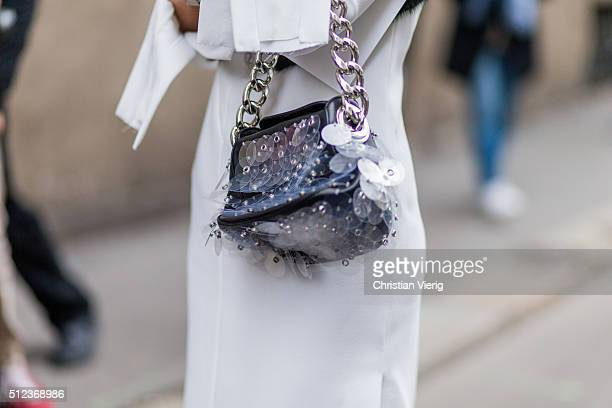 Anna dello Russo wearing a white Proenza Shouler dress with long sleeves and a Prada bag seen outside Max Mara during Milan Fashion Week Fall/Winter...