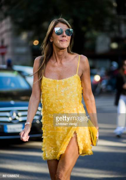 Anna dello Russo wearing a yellow dress is seen outside Prada during Milan Fashion Week Spring/Summer 2018 on September 21 2017 in Milan Italy