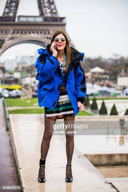 Anna Dello Russo wearing Balenciaga coat is seen in front of the Eiffel tower before the Hermes show during Paris Fashion Week Womenswear Fall/Winter...