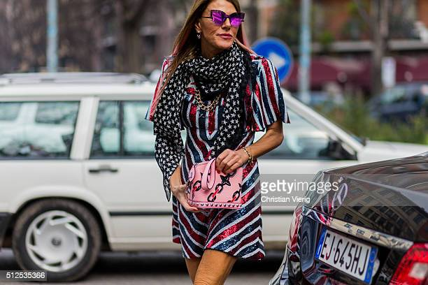 Anna dello Russo wearing Giamba dress Saint Laurent scarf and a pink Louis Vuitton bag seen outside Emporio Armani during Milan Fashion Week...