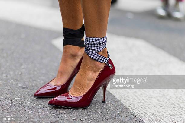 Anna dello Russo wearing Miu Miu shoes seen outside Emporio Armani during Milan Fashion Week Fall/Winter 2016/17 on February 26 in Milan Italy