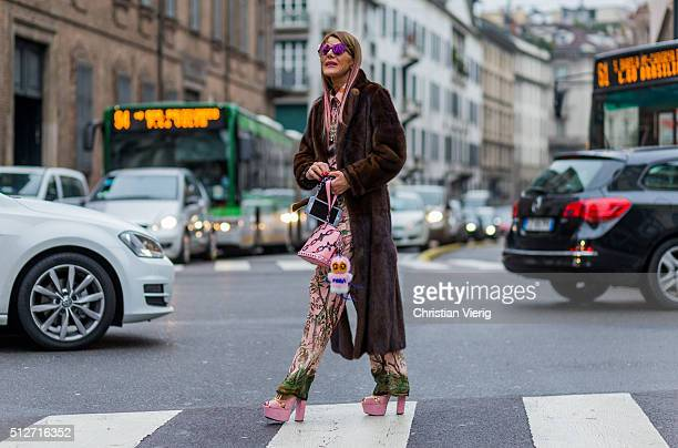 Anna dello Russo wearing Prada heels Gucci suit a pink Louis Vuitton bag Fendi Simonetta Ravizza fur coat Glassing sunglasses seen outside Blumarine...