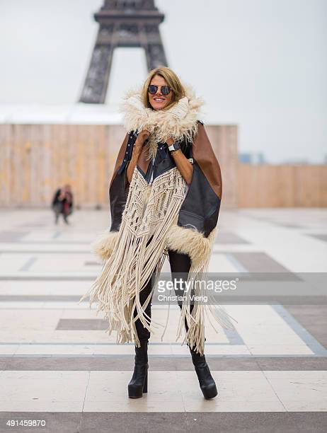 Anna dello Russo wearing Sacai coat Vetements boots Spektre glasses during the Paris Fashion Week Womenswear Spring/Summer 2016 on October 5 2015 in...