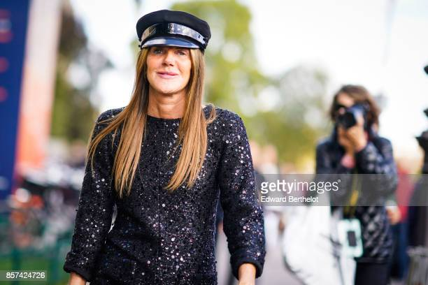 Anna Dello Russo wears a beret hat silver boots a black shiny jacket outside Chanel during Paris Fashion Week Womenswear Spring/Summer 2018 on...
