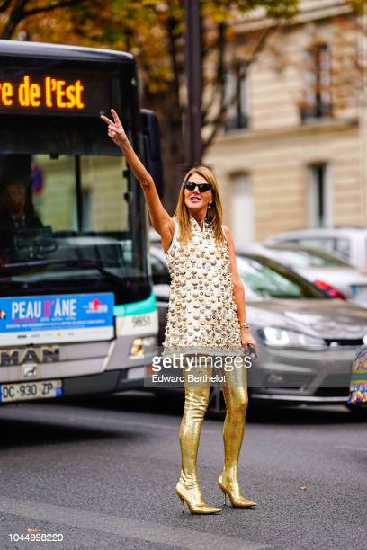 Anna Dello Russo wears a sleeveless dress with embroidered pearls golden thigh high boots outside Miu Miu during Paris Fashion Week Womenswear...