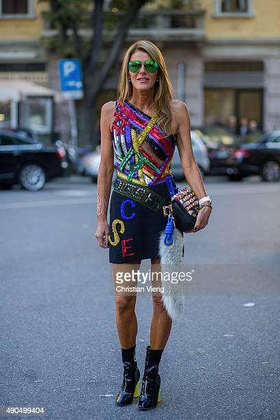 Anna dello Russo wears versace dress Victoria Beckham sunglasses Fendi bag during Milan Fashion Week Spring/Summer 16 on September 25 2015 in Milan...