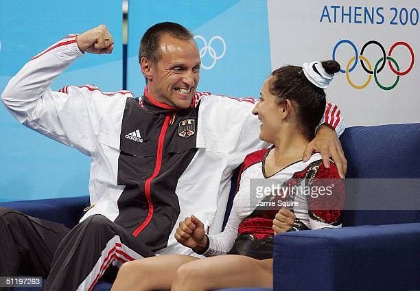 Anna Dogonadze of Germany celebrates with her coach after her routine in the women's trampoline final on August 20 2004 during the Athens 2004 Summer...
