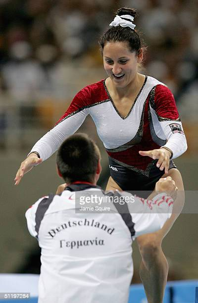 Anna Dogonadze of Germany runs into the arms of her coach after her routine in the women's trampoline final on August 20 2004 during the Athens 2004...