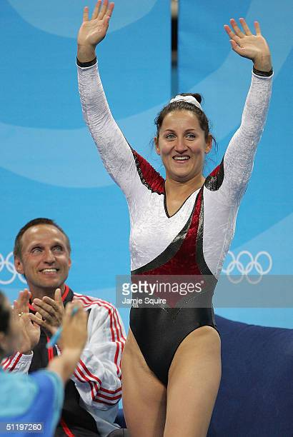 Anna Dogonadze of Germany waves to the crowd after her routine in the women's trampoline final on August 20 2004 during the Athens 2004 Summer...