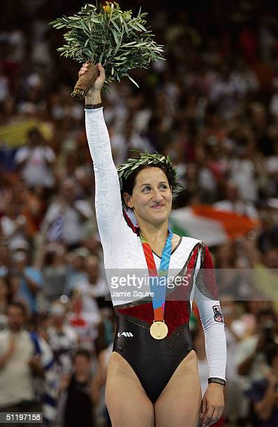 Anna Dogonadze of Germany waves to the crowd after receiving her gold medal in the women's trampoline final on August 20 2004 during the Athens 2004...