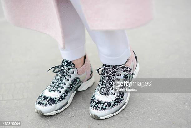 Anna Dolgova poses wearing a Rochas coat and Chanel shoes during day 3 of Paris Haute Couture Spring Summer 2015 on January 27 2015 in Paris France