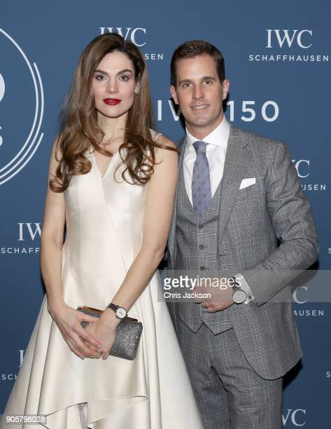 Anna Drijver and IWC Schaffhausen CEO Christoph GraingerHerr visit the IWC booth during the Maison's launch of its Jubilee Collection at the Salon...