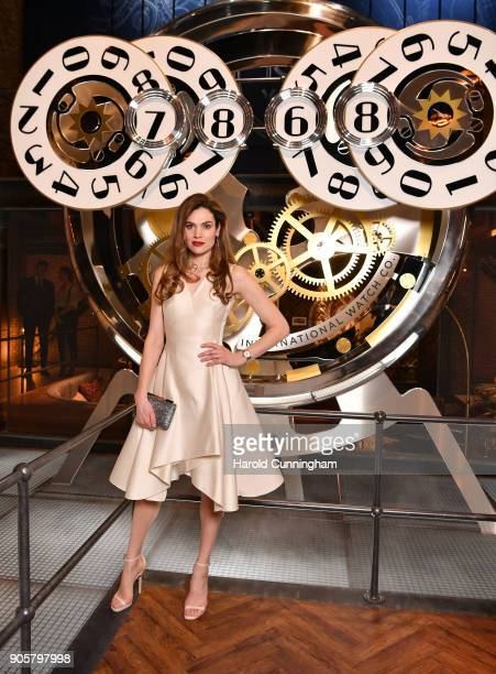 Anna Drijver visits the IWC booth during the Maison's launch of its Jubilee Collection at the Salon International de la Haute Horlogerie on January...