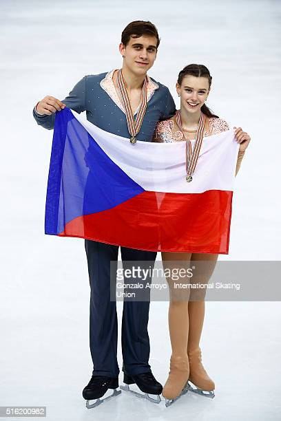 Anna Duskova and Martin Bidar from the Czech Republic pose with their flag after winning the Pair's gold medal of the of the ISU World Junior Figure...