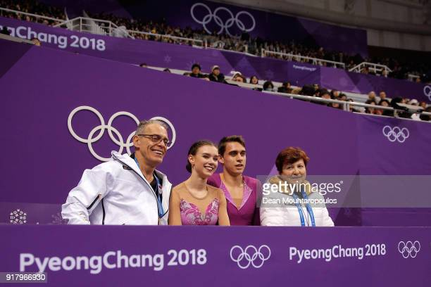 Anna Duskova and Martin Bidar of the Czech Republic sit with coaches after their routine during the Pair Skating Short Program on day five of the...