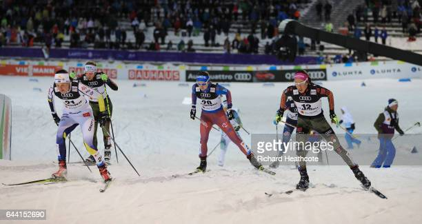 Anna Dyvik of Sweden Yulia Belorukova of Russia and Sofie Krehl of Germnay compete in the Women's 14KM Cross Country Sprint fourth quarter final...