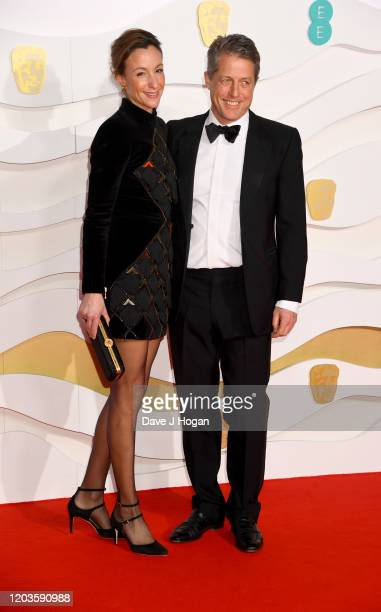 Anna Eberstein and Hugh Grant attend the EE British Academy Film Awards 2020 at Royal Albert Hall on February 02, 2020 in London, England.