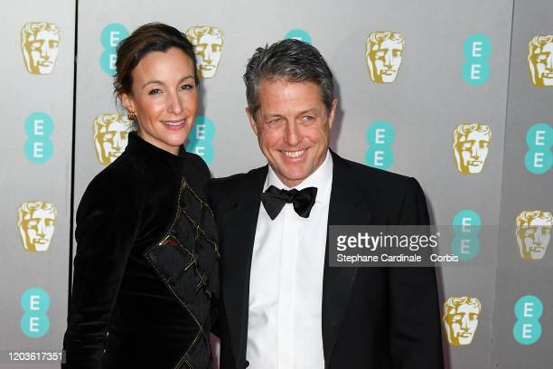 Anna Eberstein and Hugh Grant attend the EE British Academy Film Awards 2020 at Royal Albert Hall on February 02 2020 in London England